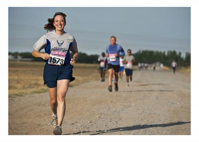 Woman running a marathon while smiling