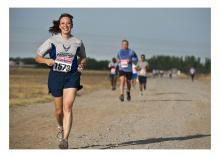 Woman running a marathon while smiling